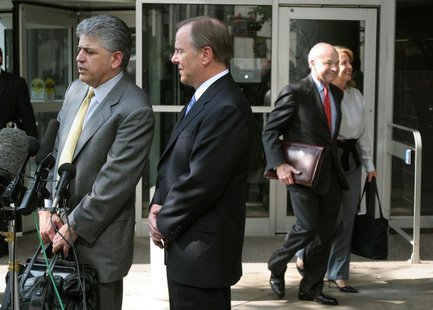 Former Enron Chief Executive Jeffrey Skilling (2L) and attorney Daniel Petrocelli (L) talk to reporters as former Enron Chairman and CEO Ken