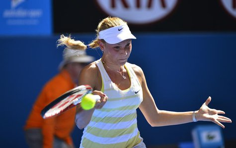 Donna Vekic of Croatia hits a return to Caroline Wozniacki of Denmark during their women's singles match at the Australian Open tennis tourn