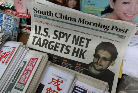 A copy of the South China Morning Post newspaper, carrying the latest interview of Edward Snowden, is displayed on a newspaper stand along w