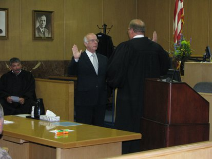 Supreme Court Judge Michael Gableman administers the oath and investiture to new Marathon County Judge Lamont K. Jacobson