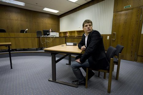 Former Tour de France winner Jan Ullrich of Germany sits in a courtroom in the western German city of Duesseldorf November 12, 2008. REUTERS