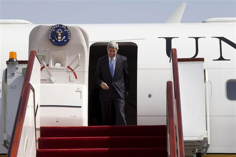 U.S. Secretary of State John Kerry disembarks from his plane as he arrives in Doha, June 22, 2013. REUTERS/Jacquelyn Martin/Pool