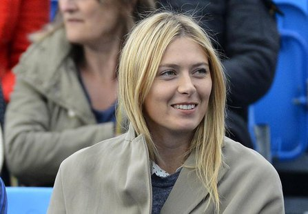 Russia's Maria Sharapova watches Bulgaria's Grigor Dimitrov play Israel's Dudi Sela in their men's singles tennis match at the Queen's Club