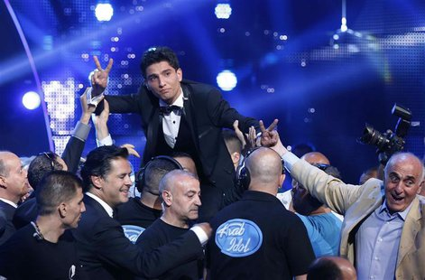 "Palestinian singer Mohammed Assaf reacts after being announced winner of the Season 2 finale of ""Arab Idol"" in Zouk Mosbeh area, north of Be"