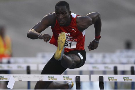 Hansle Parchment runs during the men's 110 meters hurdles semi finals at the Jamaican Olympic trials in Kingston city, June 30, 2012. REUTER