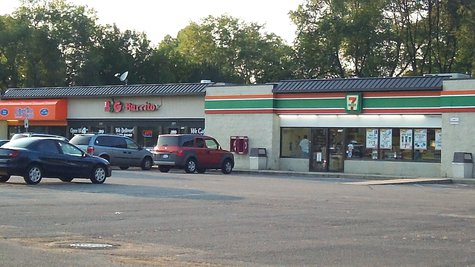 The 7-11 is located in a mini-mall just off Drake Road in an area dominated by student housing.