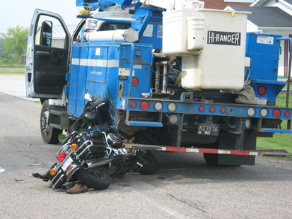 The rider of the Motorcycle was thrown to the pavement by the collision. The driver of the truck was not hurt.
