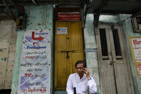 A man talks on his mobile phone by the street side of Yangon June 21, 2013. REUTERS/Soe Zeya Tun