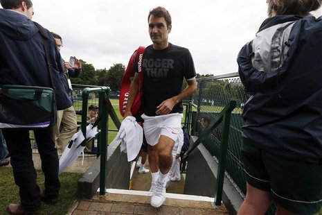 Roger Federer of Switzerland leaves a practice after a training session before the start of the Wimbledon Tennis Championships in London Jun