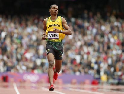 Jamaica's Warren Weir runs to finish first in his men's 200m round 1 heat at the London 2012 Olympic Games at the Olympic Stadium August 7,