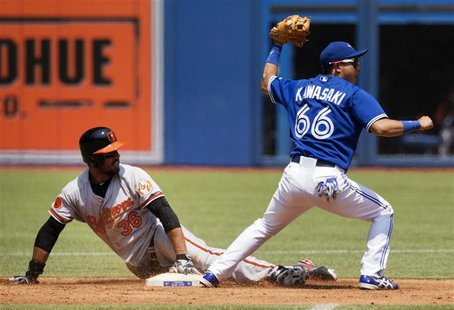 Baltimore Orioles Chris Dickerson (L) is safe at second after Toronto Blue Jays Munenori Kawasaki applied the tag during the first inning of