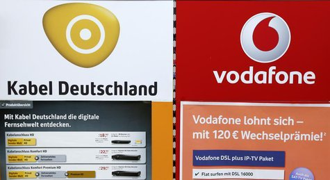 An advertising billboard of Germany's biggest cable operator Kabel Deutschland and mobile operator Vodafone is pictured in a shop in Berlin