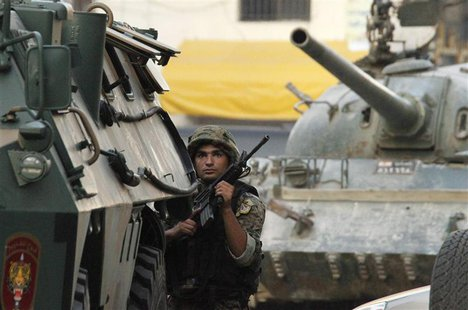 A Lebanese Army soldier takes position during clashes in Sidon, southern Lebanon, June 24, 2013. REUTERS/ Ali Hashisho