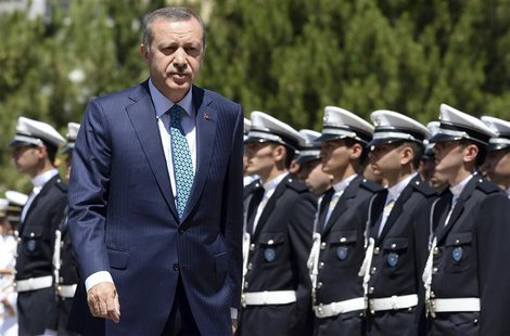 Turkey's Prime Minister Tayyip Erdogan reviews students of the Police Academy upon his arrival to their graduation ceremony in Ankara June 2