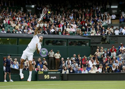 Roger Federer of Switzerland serves to Victor Hanescu of Romania in their men's singles tennis match at the Wimbledon Tennis Championships,