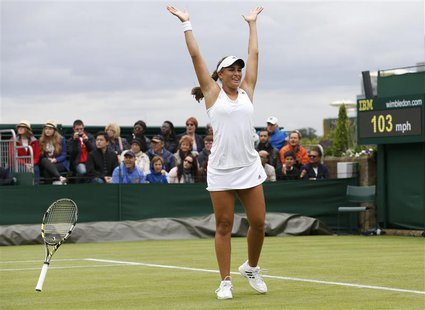 Monica Puig of Puerto Rico celebrates after defeating Sara Errani of Italy in their women's singles tennis match at the Wimbledon Tennis Cha