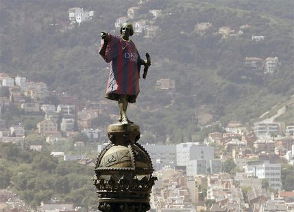 Barcelona's statue of Cristobal Colon, also known as Christopher Colombus, is seen decked out with the 2013-2014 Barcelona team soccer jerse