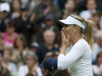 Maria Sharapova of Russia reacts after defeating Kristina Mladenovic of France in their women's singles tennis match at the Wimbledon Tennis