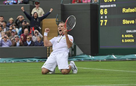 Steve Darcis of Belgium celebrates after defeating Rafael Nadal of Spain in their men's singles tennis match at the Wimbledon Tennis Champio