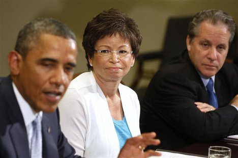 Senior Advisor Valerie Jarrett (C) listens to U.S. President Barack Obama as he meets business leaders to discuss the need for commonsense i
