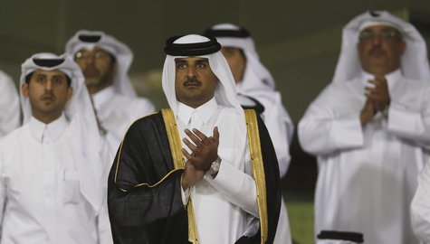 Qatar's Crown Prince Sheikh Tamim bin Hamad al-Thani (C) arrives at Al-Sadd Stadium for the final Crown Prince Cup soccer match between Qata