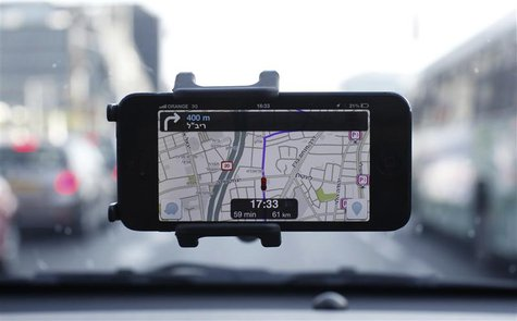 Waze, an Israeli mobile satellite navigation application, is seen on a smartphone in this photo illustration taken in Tel Aviv May 9, 2013.