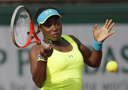 Sloane Stephens of the U.S. hits a return to Maria Sharapova of Russia during their women's singles match at the French Open tennis tourname