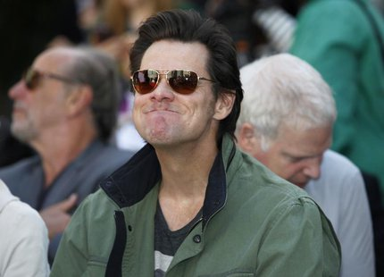 Actor Jim Carrey attends a hand and footprint ceremony for actress Jane Fonda in the forecourt of the Chinese theatre in Hollywood, Californ