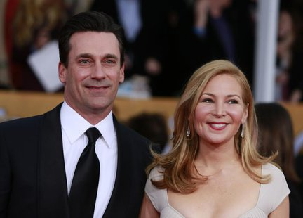 "Actor Jon Hamm of the TV drama ""Mad Men"" and his girlfriend Jennifer Westfeldt arrive at the 19th annual Screen Actors Guild Awards in Los A"
