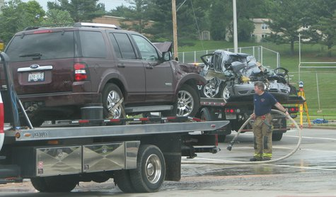 Ford Explorer and Ford Taurus loaded on tow trucks after crash at 17th Ave. and Stewart Ave. in Wausau 6/24/13