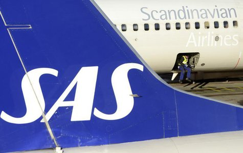 A loader sits in the cargo bay of an SAS Boeing 737 aircraft parked at Arlanda airport's Terminal Five, north of Stockholm November 13, 2012