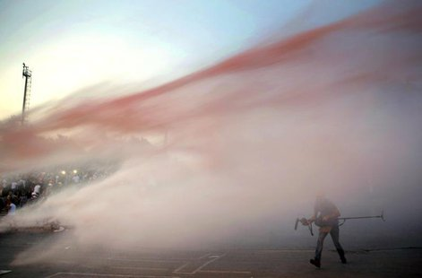Protesters are attacked by police water cannon at the entrance Gezi Park near Istanbul's Taksim square June 15, 2013. REUTERS/Yannis Behraki