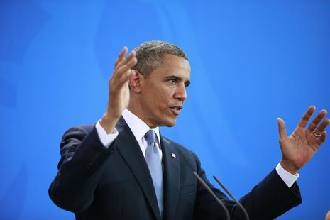 U.S. President Barack Obama gestures during a news conference after his meeting with German Chancellor Angela Merkel at the Chancellery in B