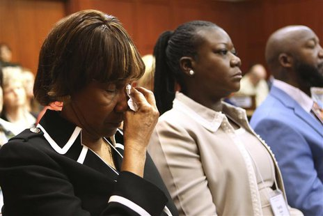 Marion Evans (L), the grandmother of Trayvon Martin, and mother of Trayvon Martin Sybrina Fulton (R), react as they listen to the descriptio