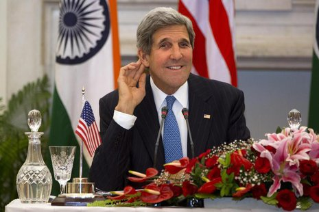 U.S. Secretary of State John Kerry smiles as he asks a reporter to repeat a question during a news conference with Indian Foreign Minister S