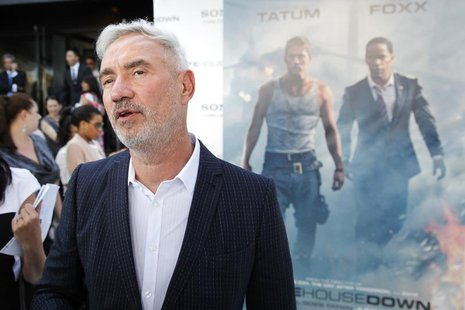 "Director Roland Emmerich walks the red carpet as he arrives for the premiere of his new film ""White House Down"" in Washington June 21, 2013."