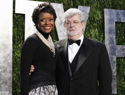 Director George Lucas and his partner Mellody Hobson arrive at the 2012 Vanity Fair Oscar party in West Hollywood, California February 26, 2