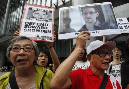 Protesters in support of Edward Snowden, a contractor at the National Security Agency (NSA), chant slogans before marching to U.S. Consulate