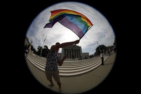 Gay marriage supporter Vin Testa waves a rainbow flag in anticipation of U.S. Supreme Court rulings in the cases against California's gay ma