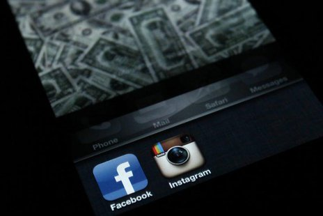 A photo illustration shows the applications Facebook and Instagram on the screen of an iPhone in Zagreb April 9, 2012. REUTERS/Antonio Broni