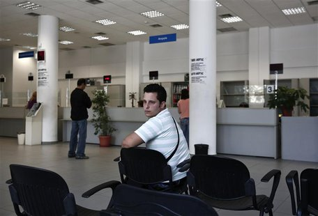 Greek Vangelis Xideas, 25, waits inside a Greek Manpower Employment Organisation office at a suburb of Athens June 14, 2013. REUTERS/Yorgos