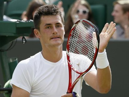 Bernard Tomic of Australia celebrates after defeating Sam Querrey of the U.S. in their men's singles tennis match at the Wimbledon Tennis Ch