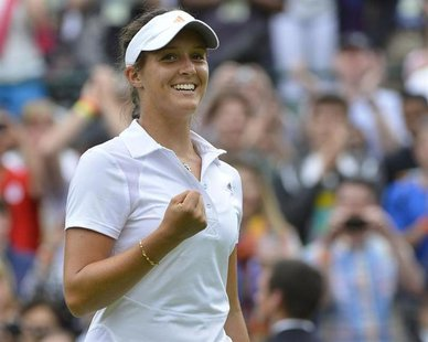 Laura Robson of Britain celebrates after defeating Maria Kirilenko of Russia in their women's singles tennis match at the Wimbledon Tennis C