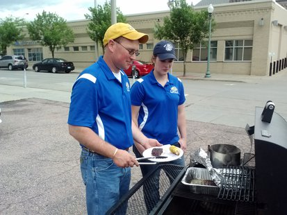 Keith Underwood and Christina Fehrman demonstrate the many methods of the backyard barbeque.  (KELO/KELQ)