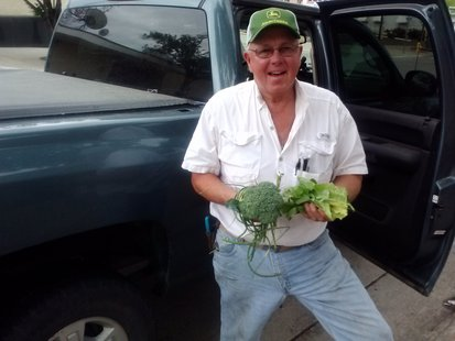 Sam Heikes shows off fresh produce from the Heikes Family Farm. (KELO/KELQ)