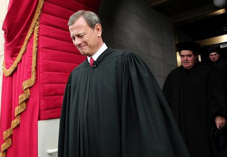 Supreme Court Chief Justice John Roberts is followed by Supreme Court Justice Antonin Scalia as they arrive for the presidential inauguratio