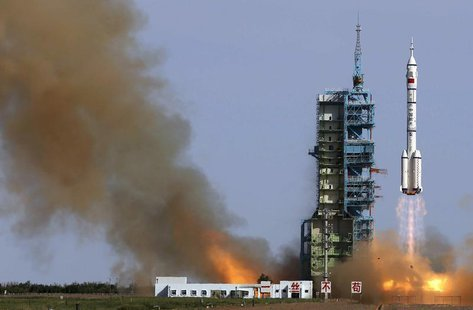 The Long March 2-F rocket loaded with Shenzhou-10 manned spacecraft carrying Chinese astronauts Nie Haisheng, Zhang Xiaoguang and Wang Yapin