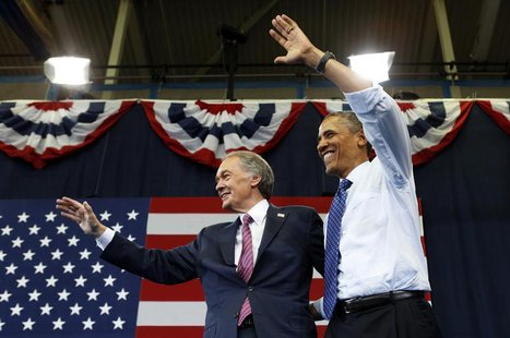 U.S. President Barack Obama (R) waves with U.S. Senate candidate Edward Markey during a campaign rally in Boston June 12, 2013. REUTERS/Kevi