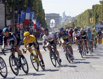 Sky Procycling rider and leader's yellow jersey Bradley Wiggins of Britain (2ndL) cycles on the Champs Elysees during the final 20th stage o