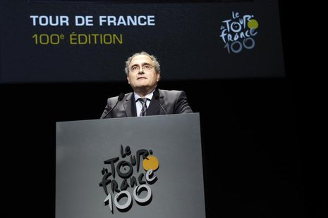 Corsica executive council president Paul Giacobbi poses next to the itinerary of the 2013 Tour de France cycling race during a presentation